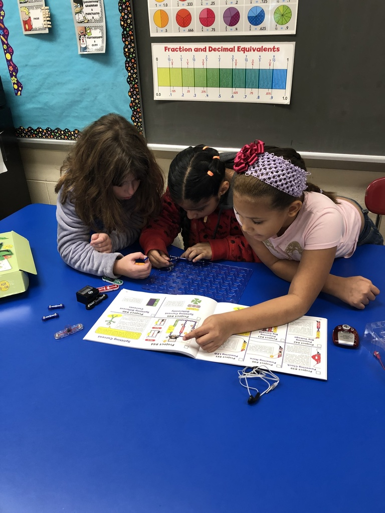 Creating a snap circuit together.