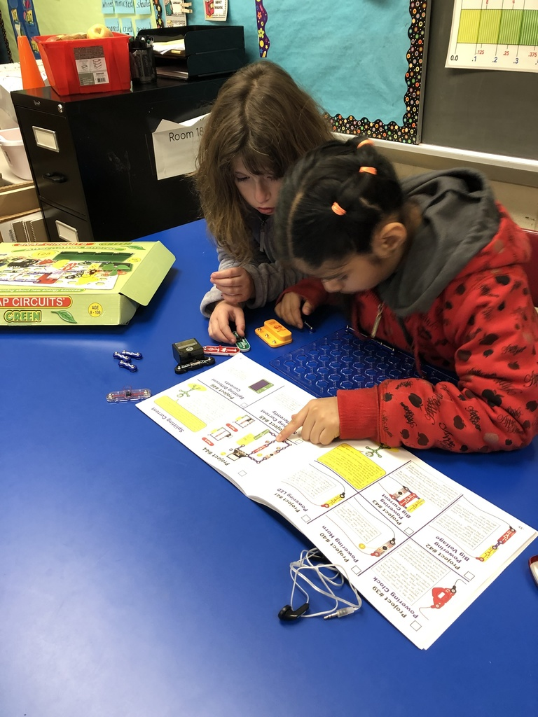 Following directions for creating a snap circuit.