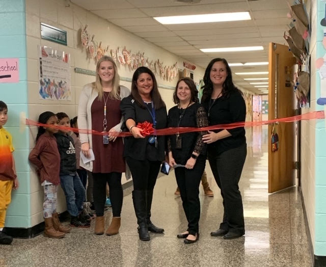 Judd teachers cutting the ribbon to offically open our sensory path!