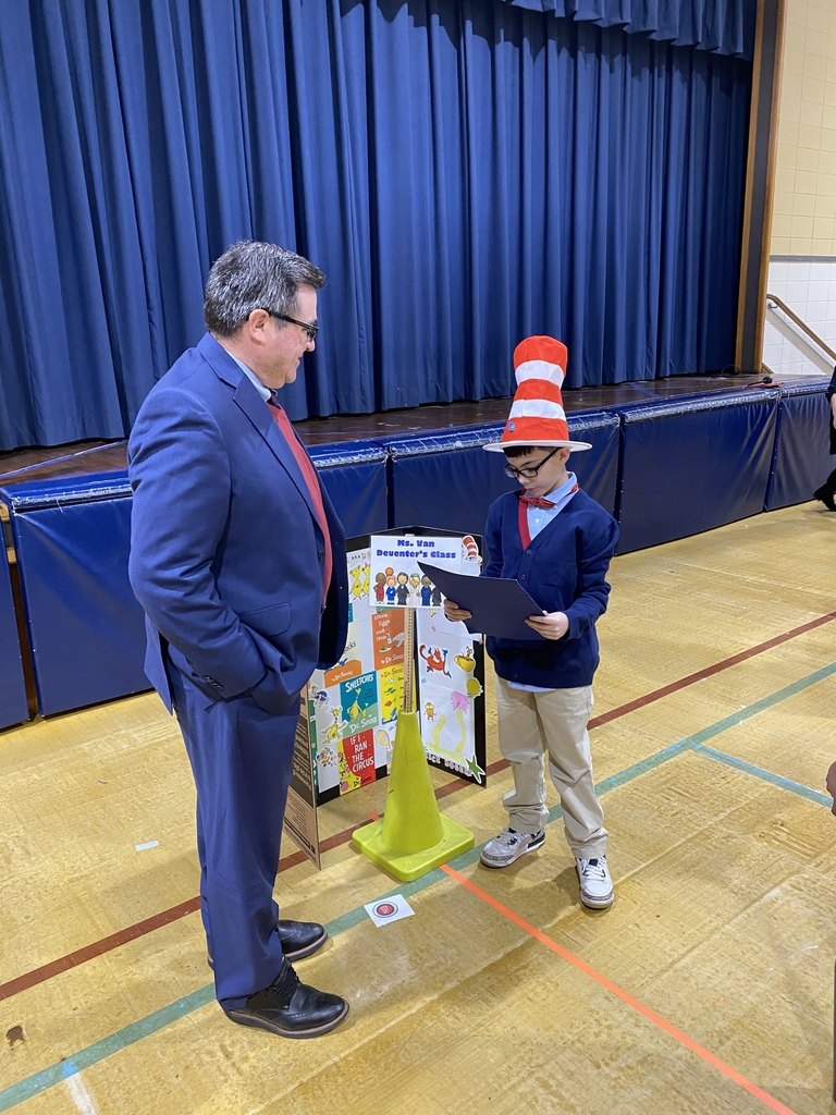 Dr. Zychowski came to support our students and received a lesson from Dr. Seuss